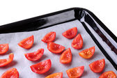 Tomatoes on drying tray, isolated on white — Stock fotografie