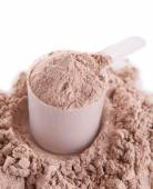 Whey protein powder in scoop isolated on white — Stock Photo