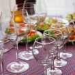 Buffet table with dishware waiting for guests — Stock Photo #52337873