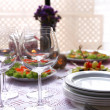 Buffet table with dishware waiting for guests — Stock Photo #52337879