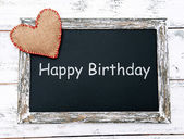Happy birthday written on chalkboard, close-up — Foto Stock