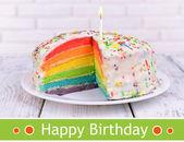 Birthday postcard.Delicious rainbow cake — Stock Photo