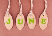 Juin tags sur fond marron — Photo