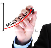 Businessman hand draws business success chart isolated on white — Stock Photo