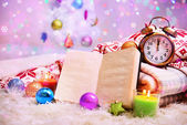 Composition with plaids, candles and Christmas decorations on bright background — ストック写真