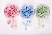 Beads in glass bowls isolated on white — Stock Photo