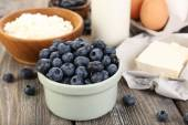 Fresh blueberries and milk products on wooden table — Stock Photo