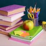 School supplies on table on board background — Stock fotografie