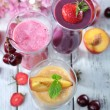 Delicious smoothie on table, close-up — Stock Photo #52348113