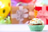 Delicious birthday cupcake on table on bright background — Stock Photo