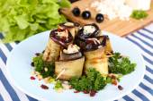 Fried aubergine with cottage cheese and parsley on a napkin on wooden background — Stock Photo