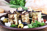 Fried aubergine with cottage cheese in a round plate on wooden cutting board on wooden background — Stock Photo