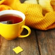 Cup of tea with tea bag on wooden table close-up — Stock Photo #52355833