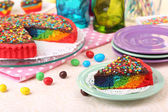 Delicious rainbow cake on table, on bright background — Foto Stock