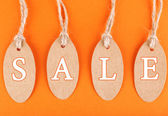 Sale tags on colorful background — Stock Photo
