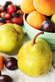 Ripe fruits and berries on table close up — Stock fotografie