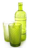 Green glass bottle and glasses, isolated on white — Stock fotografie