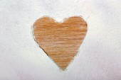 Heart figure made of sugar powder on wooden background — Stock Photo
