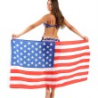 Beautiful young woman in swimsuit with with American flag isolated on white — Stock Photo #52526765