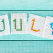 Word made from embroidered letters — Stock Photo #52528689