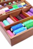 Colorful threads for needlework in wooden box close up — Stock Photo