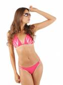 Beautiful young woman in pink swimsuit isolated on white — Stock Photo