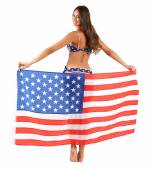 Beautiful young woman in swimsuit with with American flag isolated on white — Stock Photo