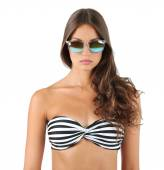 Beautiful young woman in striped swimsuit isolated on white — Stock Photo