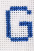 Handmade embroidered letter — Stock Photo