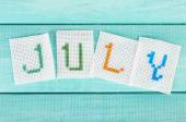 Word made from embroidered letters — Stock Photo