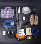 Musical equipment, clothes and footwear on dark background — Foto Stock