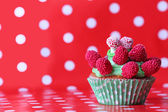 Delicious birthday cupcake on red  background — Stock Photo