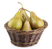 Ripe pears in basket isolated on white — Stock Photo