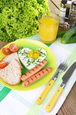 Scrambled eggs with sausage and vegetables served on plate on napkin — Stock Photo