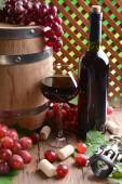 Wine with grapes on table on brown background — Foto Stock