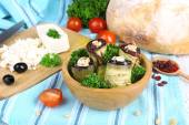 Fried aubergine in a bowl with cottage cheese, bread and parsley on wooden background — Stock Photo
