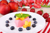 Heart shaped cake with fruits and berries on plate on napkin — Zdjęcie stockowe