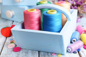 Sewing Accessories in wooden boxes on table close-up — Stock Photo