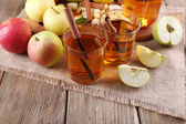 Still life with apple cider and fresh apples on wooden table — Stock Photo