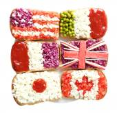 Sandwiches with  different flags isolated on white — Stock Photo