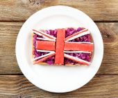 Sandwich with flag of Great Britain on table close-up — Stock Photo