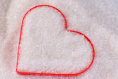 Heart covered in white sugar, close-up — Stock Photo