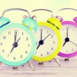 Colorful alarm clocks on table — Stock Photo #52694981