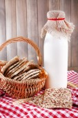 Tasty snack in basket on wooden background indoor — Stock Photo