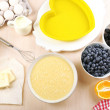 Baking tasty pie and ingredients for it on table in kitchen — Stock Photo #52700945