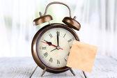 Alarm clock with sticker — Stock Photo