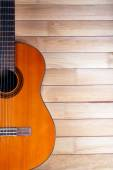 Acoustic guitar on wooden background — Stock Photo