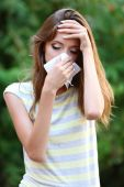 Young girl with allergy outdoors — Stock Photo