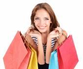 Piękna młoda kobieta z torby na zakupy na białym tle — Zdjęcie stockowe