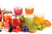 Glasses of tasty fresh juice, isolated on white — Stock Photo